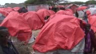 Various shots of newly displaced Somalians who live in makeshift tents on the outskirts of Mogadishu Somalia on April 25 2017 Somalia's current...