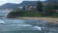 Various shots of of the coastline looking south from Austinmer including Bells Point Thirroul and the Illawarra Escarpment Gentle waves lap ashore...