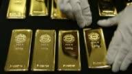 Various shots of one kilogram gold bars being arranged at a Tanaka Kikinzoku Kogyo K K store in Tokyo Japan on Tuesday March 25 A close up of gold...