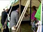 Various shots of Prince Charles and Camilla Duchess of Cornwall looking around the Sandringham Women's Institute tent at Sandringham Flower Show...