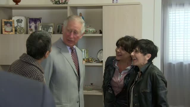 Various shots of Prince Charles meeting a family affected by the 2016 Amatrice earthquake on April 02 2017 in Amatice Italy