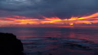 Various shots of sun rising over the Pacific Ocean off Austinmer beautiful colors yellow purple and orange reflecting through the clouds and on the...