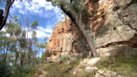 Various shots of the ancient layered sandstone rockface walls that make up Dandry Gorge the surrounding Australian bush scrub of the Pilliga Forest...