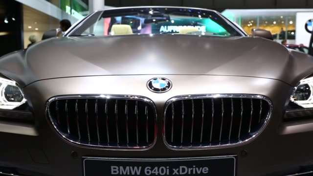 Various shots of the BMW 640i xDrive at the 2014 Geneva Motor Show in Geneva Switzerland on March 5 A sliding tight shot of the front end of the BMW...