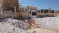 Various shots of the destroyed hospital after warcrafts belonging to Syrian regime carried out air strikes in Idlib's Kafr Nabil town which is under...