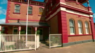 Various shots of the exterior of the beautifully restored Gundagai Post Office with Australian flag on pole