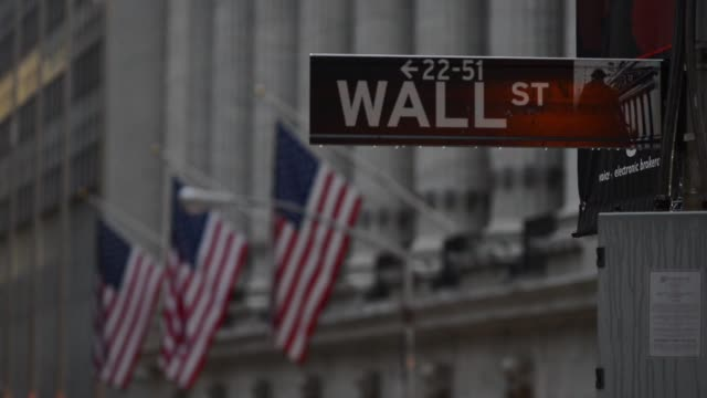 Various shots of the exterior of the New York Stock Exchange exteriors on an a rainy day in Lower Manhattan New York City A tight rack focus shot of...