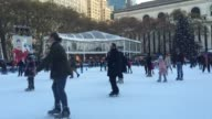 Various shots of the fountain shops and crowds at Bryant Park's Winter Village in New York