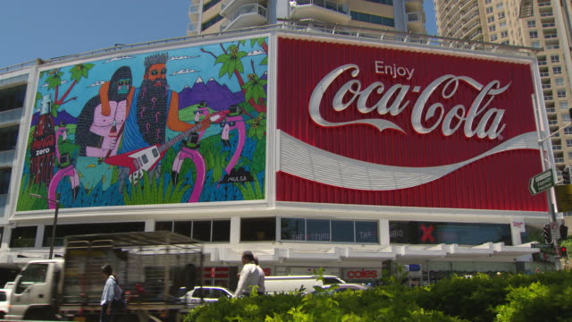 Various shots of the new CocaCola advertising neon billboard sign at Kings Cross Sydney side by side with a new Coke Zero advertisement by artist...