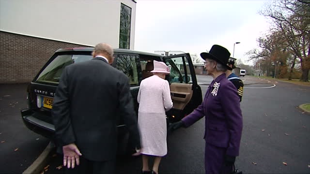 Various shots of the Queen receiving a bouquet of flowers and speaking to pupils with Prince Philip Duke of Edinburgh before departing Holyport...