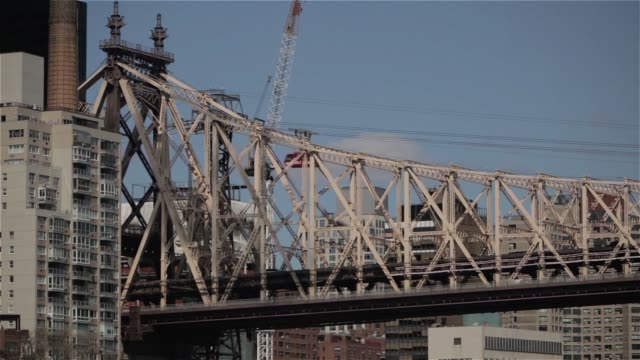 Various shots of the Queensboro Bridge and the Harlem River from Roosevelt Island in New York City New York on March 24 A tilt panning shot of the...