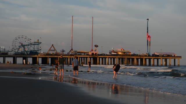 Various shots of the Steel Pier amusement area from the beach on a cloudy evening in Atlantic City New Jersey