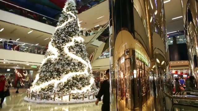 Various shots shoppers walk past a Christmas tree at Cityplaza shopping mall operated by Swire Properties Ltd in the Taikoo Shing area of Hong Kong...