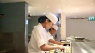 Various shots Sushi chefs work and prepare dishes in the kitchen at the Nobu London luxury restaurant inside the Metropolitan Hotel in London UK on...