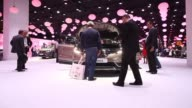 Various shots visitors look at a new Renault Espace automobile produced by Renault SA on its debut day at the Paris Motor Show in Paris France on...