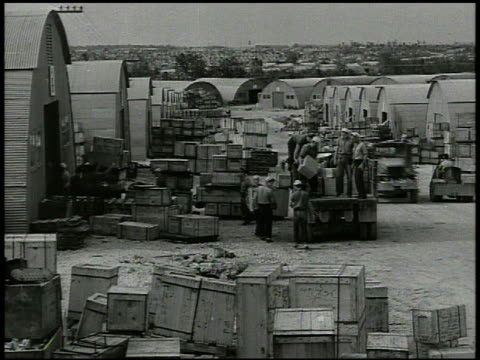 Various soldiers moving stockpiles of goods foods canisters male checking stockpile of aerial bombs World War II WWII Mariana Islands stock supplies...