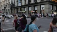 Various street scenes and exteriors of shoppers walking through the heart of SoHo in Manhattan New York on May 12th 2015 Shots Wide shots of crowded...