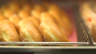 Various tight shots of various Dunkin Donut products in Canton MA on September 20 A tight slow motion tracking shot of jelly and glazed doughnuts in...