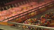 Various tight shots of various Dunkin Donut products in Canton MA on September 20 A tight shot of chocolate and strawberry covered doughnuts with...