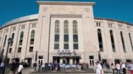 Various time lapse shots of the exteriors of Yankee Stadium in Bronx New York Time lapse shots of people walking around the exterior of Yankee...