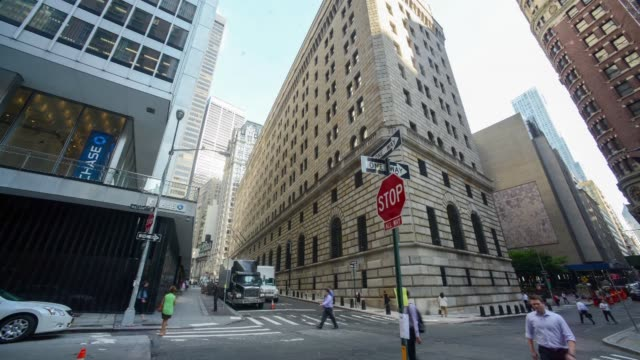 Various time lapse shots of the Federal Reserve Bank of New York in downtown Manhattan New York Time lapse shots of clouds rapidly passing over the...