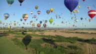 AERIAL WS Vast array of vibrant colored hot air balloons taking off / Alsace - Lorraine, France