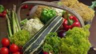 T/L, CU, Vegetables rotting in wooden basket