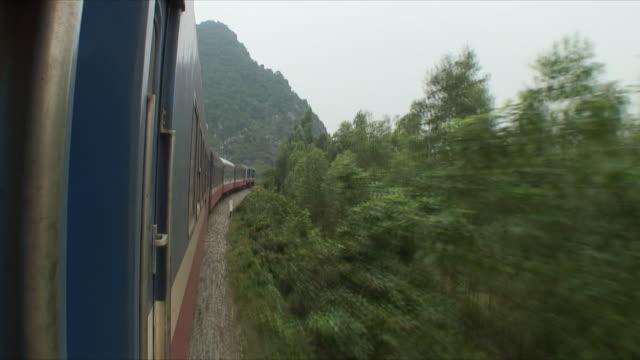 WS POV Vegetation along train tracks, Northern Countryside, Vietnam