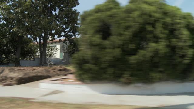 WS POV Vehicle moving on residential boulevard / Pasadena, California, USA