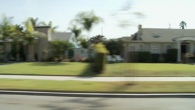 WS POV Vehicle moving through residential area on sunny day / Pasadena, California, USA