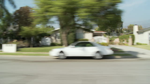 WS POV Vehicle moving through residential area / Pasadena, California, USA