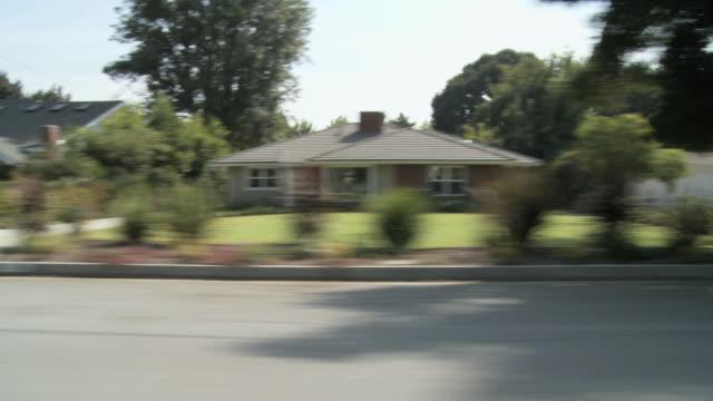 WS POV Vehicle moving through suburban on sunny day / Pasadena, California, USA