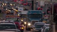 Vehicles edge through a heavy traffic jam  in Charlotte, North Carolina.