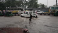 Vehicles floundering in the water during a tropical monsoon rain and flooding in Chittagong, Chittagong, Bangladesh, Indian Sub-Continent, Asia