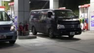 Vehicles refuel at a China Petroleum Chemical Corp gas station at dusk in Hong Kong China on Tuesday Aug 22 A China Petroleum Chemical Corp gas...