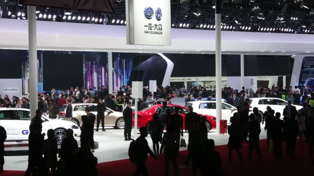 WS Vehicles stand on display at the 16th Shanghai International Automobile Industry Exhibition in Shanghai China WS Visitors walk past the Mitsubishi...