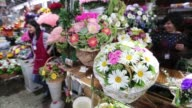 A vendor organises flowers for her display at the Rizhsky flower market in Moscow Russia on Friday Aug 28 2015 Shots Close up of a bouquet of roses...