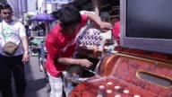A vendor repairs a speaker in a repair shop at Quiapo Market in Manila the Philippines on Sunday Feb 5 A woman uses a mobile phone inside an...