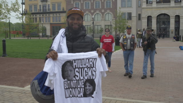 Vendor sales anti Hillary Clinton tshirts before 2016 Republican presidential candidate Donald Trump speaks during a campaign stop and town hall at...