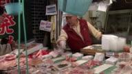 Vendor selling meat at Tsukiji fish market / Tokyo
