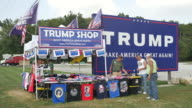 A vendor sells Donald J Trump for president merchandise including campaign buttons and tshirts at a Trump Shop along a highway outside of Madison...