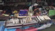 Vendors prepare food at the Taling Chan Floating Market in Bangkok