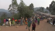 Vendors sell their products at a market in Ruhija, Uganda. Available in HD.