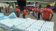 Venezuela on Tuesday sends supplies including bottled water and mattresses to Dominica after it was battered by Hurricane Maria