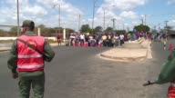 Venezuelan citizens in Paraguachon in Colombia wait to cross back into Venezuela on Wednesday after Nicolas Maduro late Monday said he had ordered...
