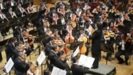 Venezuelan maestro Gustavo Dudamel conducts a concert with the Simon Bolivar National Youth Orchestra in Caracas during international peace day in...