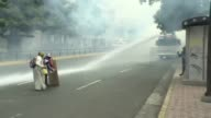Venezuelan opposition demonstrators clash with police Wednesday after protesters once again took to the streets of Caracas to demand that President...