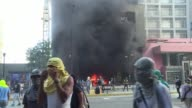 Venezuelan protesters set the Supreme Court's administrative headquarters on fire on Monday in a new bout of violence in the country's capital...