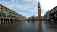 Venice's St Mark's square is flooded during an acqua alta a phenomenon that hits the coastal Italian city because of the combination of a high tide...
