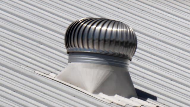 ventilator spins in the sunlight.